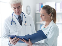 Doctor checking medical records Royalty Free Stock Image