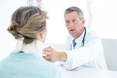 Doctor checking neck brace of his patient Royalty Free Stock Photography