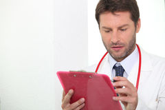 Doctor checking notes Royalty Free Stock Images