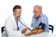 Doctor checking patient blood pressure. Royalty Free Stock Images