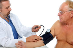 Doctor checking patient blood pressure. Doctor checking old men patient arterial blood pressure. Health care Royalty Free Stock Photography