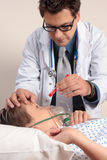 Doctor checking patient eyes Stock Photo