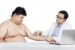 Doctor checking patient heartbeat Royalty Free Stock Photo