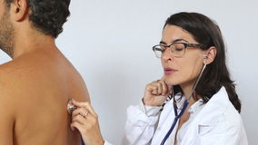 Doctor checking a patient stock video