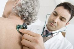 Doctor Checking Patient's Back Using Stethoscope Royalty Free Stock Photography