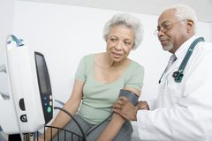 Doctor Checking Patient's Blood Pressure Royalty Free Stock Photography