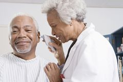 Doctor Checking Patient's Ear Using Electronic Otoscope Stock Images