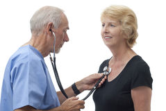Doctor checking patient's heartbeat Stock Photography