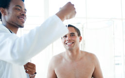 Doctor checking patient's temperature Royalty Free Stock Images