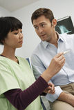 Doctor Checking Patient's Temperature Stock Image