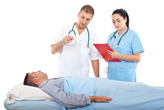Doctor checking patient temperature royalty free stock images