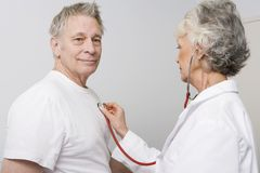 Doctor Checking Patient Using Stethoscope Stock Image