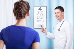 Doctor checking patient vision Royalty Free Stock Image