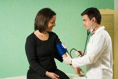 Doctor Checking Patients Blood Pressure - horizont Stock Photos