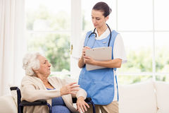 Doctor checking patients health Stock Image