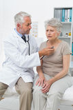 Doctor checking patients heartbeat using stethoscope Royalty Free Stock Images