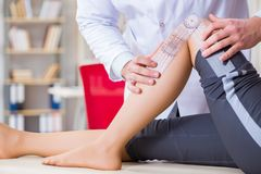 The doctor checking patients joint flexibility Royalty Free Stock Image