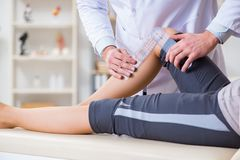 The doctor checking patients joint flexibility Royalty Free Stock Images