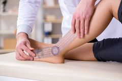 The doctor checking patients joint flexibility Stock Image