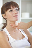 Doctor checking pulse on throat Royalty Free Stock Images