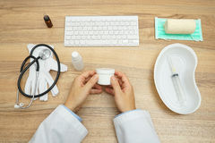 Doctor is checking and repiraing medication in his hands royalty free stock photos