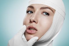 Doctor is checking the result of lips pushup Stock Photography