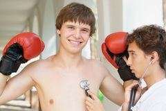 Doctor checking a smiling boxer Stock Photography