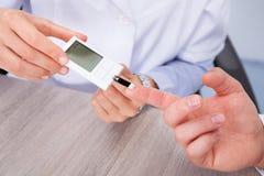 Doctor checking sugar level Stock Image