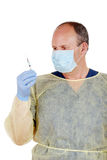 Doctor checking a syringe Stock Photography