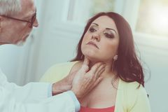 Doctor checking thyroid Stock Photo