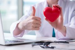The doctor checking up heart in medical concept. Doctor checking up heart in medical concept royalty free stock image