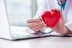 The doctor checking up heart in medical concept. Doctor checking up heart in medical concept stock photo