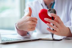 The doctor checking up heart in medical concept. Doctor checking up heart in medical concept royalty free stock images