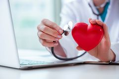 The doctor checking up heart in medical concept. Doctor checking up heart in medical concept stock images