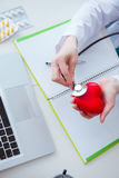 The doctor checking up heart in medical concept. Doctor checking up heart in medical concept stock image
