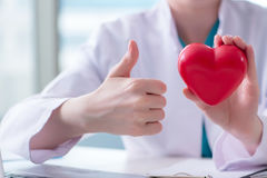The doctor checking up heart in medical concept royalty free stock image