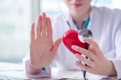 The doctor checking up heart in medical concept. Doctor checking up heart in medical concept royalty free stock photo