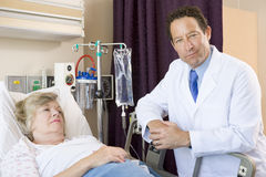 Doctor Checking Up On Patient In Hospital Royalty Free Stock Photography