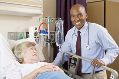 Doctor Checking Up On Patient In Hospital royalty free stock photo