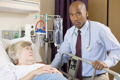 Doctor Checking Up On Patient,Looking Serious Royalty Free Stock Image