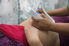 Doctor Checking  Up Young Asian Woman`s Belly. In the hospital.Pregnancy check up Stock Images