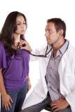 Doctor checking womans heart Stock Photos