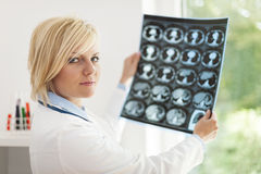 Doctor checking x-ray results Royalty Free Stock Images