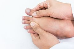 Free Doctor Checks A Patient`s Toe Nails That Child Because The Child`s Unusual Nails Can Tell The Symptoms Of The Disease. Royalty Free Stock Image - 99443206