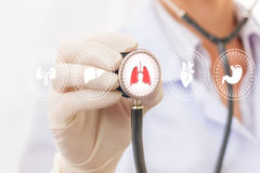 The doctor checks the patient`s lungs . Royalty Free Stock Images