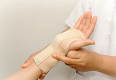 Doctor checkup the patient's arm Stock Images