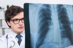 Doctor with chest x-ray Stock Photography
