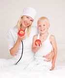 Doctor and a child Stock Photography