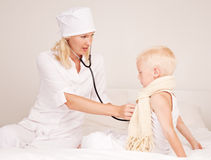 Doctor and a child Royalty Free Stock Photography