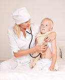 Doctor and a child Stock Image